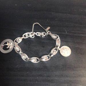 Vintage Monet silvertone charm bracelet w/2 charms